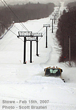 Stowe Groomer fights through deep snow.