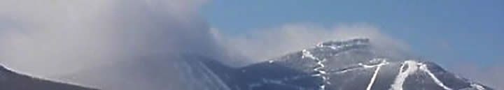 You can often tell when it is snowing at Jay Peak. You'll see the upper mountain shrouded in cloud. The cloud almost seems to cling to the peaks of the ski resort. But, the cloud can also signify high wind!