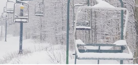 chair lifts covered in snow